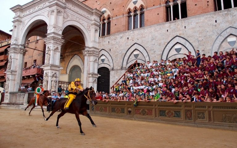In front of the Torre di Mangia in the Piazza il Campo for the Siena Palio :: Bike Florence & Tuscany
